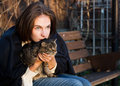 Young woman with a cat gray striped Royalty Free Stock Photos