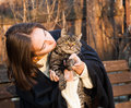 Young woman with a cat gray striped Royalty Free Stock Photography