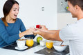 Young woman caught because her boyfriend gives an engagement rin women ring at breakfast Royalty Free Stock Photo