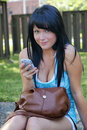 Young woman with cellphone Royalty Free Stock Photography