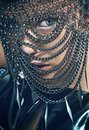 Young woman with chain mask Royalty Free Stock Photo