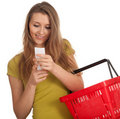 Young woman  checking purchases list Royalty Free Stock Photography