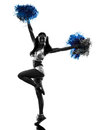 Young woman cheerleader cheerleading silhouette one studio on white background Stock Image