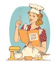Young woman chef in retro style clothes cooking and holding cook book in her hand Royalty Free Stock Photo