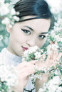 Young woman with cherry flowers portrait Stock Image