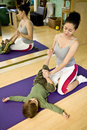 Young woman with child doing Pilates Royalty Free Stock Photo