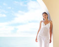 A young woman chilling at the turist resort and attractive brunette in white dress image has lot of blank space Royalty Free Stock Photo