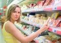 Young woman choosing meat.