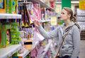 Young woman is choosing toys for her kid middle shot Stock Photo