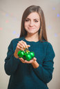 Young woman with christmas ball isolated on white Royalty Free Stock Image