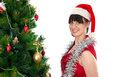 Young woman and christmas tree Royalty Free Stock Photo