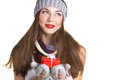 Young woman with christmass gift beautiful in winter clothing in red box on white background Royalty Free Stock Photos