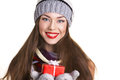 Young woman with christmass gift beautiful in winter clothing in red box on white background Royalty Free Stock Photography