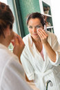Young woman cleaning face cotton pads bathrobe Royalty Free Stock Photography