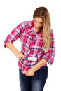 Young woman cleaning her shirt with lint roller Royalty Free Stock Photo