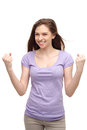 Young woman clenching fists with arms raised Royalty Free Stock Photo