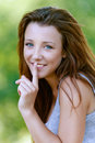 Young woman close-up puts finger Royalty Free Stock Image