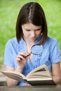 Young woman close-up reading book Royalty Free Stock Images