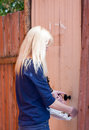 Young woman closes the door Royalty Free Stock Photo