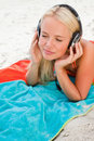 Young woman closing her eyes while listening to music on her bea Stock Photo