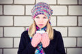 Young woman with cofee cup winter time wearing knitted sweater hat and scarf mittens lifestyle concept trendy colors Royalty Free Stock Image