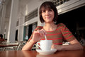 Young woman in coffee shop Royalty Free Stock Image