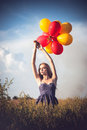 Young woman with colorful balloons beautiful Royalty Free Stock Photos