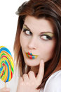 Young woman with colorful lollipop Royalty Free Stock Image