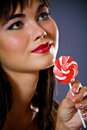 Young woman with colourful lollipop candy Stock Photo