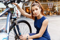 Young woman commuting on bicycle in business wear in city Royalty Free Stock Photos