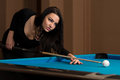 Young woman concentration on ball lining to hit pool table Stock Image