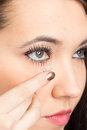 Young woman with contact lense Stock Photography