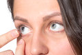Young woman with contact lenses inserting to eye Royalty Free Stock Photos