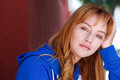 Young woman in contemplation leaning head on hand Royalty Free Stock Photo