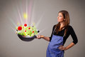 Young woman cooking fresh vegetables beautiful with abstract lights Royalty Free Stock Photo