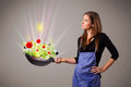 Young woman cooking fresh vegetables beautiful with abstract lights Stock Photos
