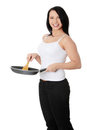 Young woman cooking healthy food Stock Photography