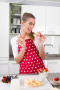 Young woman cooking and posing in the kitchen time for breakfa breakfast Stock Photography