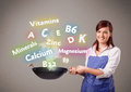 Young woman cooking vitamins and minerals pretty Royalty Free Stock Images