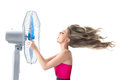 Young woman with cooler fan cooling face under wind of isolated on white background Royalty Free Stock Image