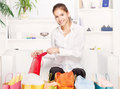 Young woman on couch with shopping bags Stock Photography