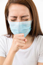 Young woman cough with protective face mask Royalty Free Stock Photo