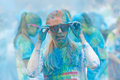 Young woman covered with blue color powder fixing the glasses stockholm may her in public event run may in stockholm Stock Image