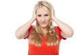 Young woman covering her ears annoyed lady Royalty Free Stock Photo