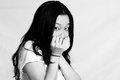 Young woman covering her face Royalty Free Stock Photo