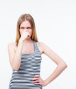 Young woman covering her nose with hand Royalty Free Stock Photo