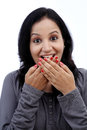 Young woman covering mouth with her hands and laughing against white Royalty Free Stock Photo