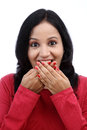 Young woman covering mouth with her hands Stock Image