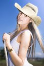 Young woman with cowboy hat Stock Photos