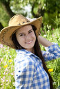 Young woman in cowboy hat Stock Images